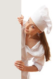 Woman chef, baker or cook holding white paper sign Stock Photography