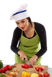 Woman chef chopping vegetables Royalty Free Stock Images