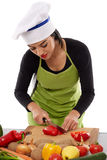 Woman chef chopping vegetables Stock Image