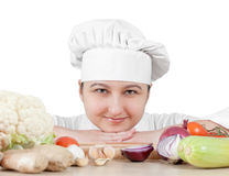 Chef chops vegetables for cooking Royalty Free Stock Images