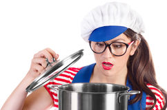 Woman chef cook holding pot. Isolated on a white background Stock Image