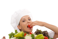 Woman chef or cook and vegetables Stock Photos