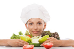 Woman chef or cook and vegetables Stock Images