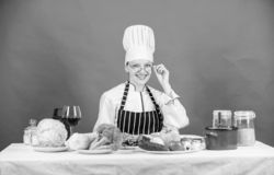 Woman chef cooking healthy food. Culinary school concept. Female in apron knows everything about culinary art. Culinary. Education. Fresh vegetables ingredients stock image