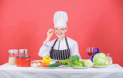 Woman chef cooking healthy food. Culinary school concept. Female in apron knows everything about culinary art. Culinary. Education. Fresh vegetables ingredients stock photography