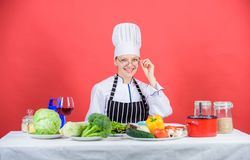 Woman chef cooking healthy food. Culinary school concept. Female in apron knows everything about culinary art. Culinary. Education. Fresh vegetables ingredients royalty free stock photography