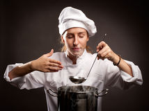 Woman chef cooking Royalty Free Stock Image