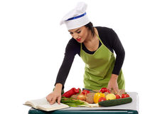 Woman chef cooking vegetables Royalty Free Stock Photo