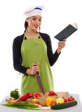 Woman chef cooking vegetables Royalty Free Stock Images