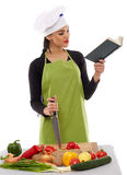 Woman chef cooking vegetables Stock Photography