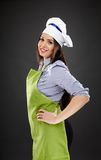 Woman chef with hand on hip Stock Photos