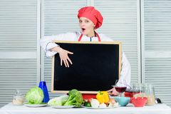 Woman chef hat apron hold blackboard copy space. Chef job position. Cooking delicious meal step by step. Cooking menu. For today. List ingredients cooking dish stock image