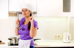 Woman chef having a brainwave Royalty Free Stock Photos