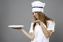 Woman Chef hold a plate and presenting Stock Photos