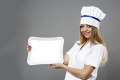 woman Chef hold a plate and presenting Stock Image