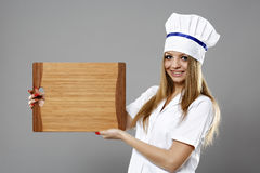 Woman Chef hold a plate and presenting Royalty Free Stock Photos