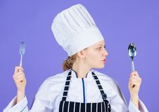 Woman chef hold utensil spoon fork. Appetite and taste. Traditional culinary meal. Professional cook and cooking at home. Tasty homemade food. Time to try meal royalty free stock image