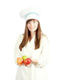 Woman chef  holding apples Royalty Free Stock Photos