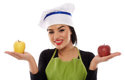 Woman chef holding apples Royalty Free Stock Images