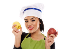 Woman chef holding apples Stock Photos