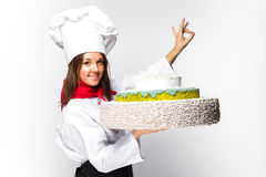 Woman chef holding a cake Stock Image