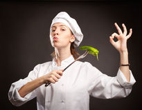 Woman chef holding a green pepper Stock Photography