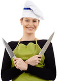 Woman chef holding knives Royalty Free Stock Photo