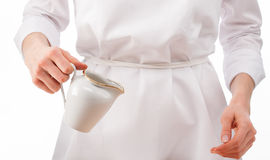 Woman chef holding milk jug Royalty Free Stock Photography