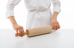 Woman chef holding rolling pin Stock Photo