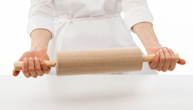 Woman chef holding rolling pin Royalty Free Stock Photos