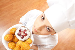 Woman chef holding tray of cookies. Royalty Free Stock Images