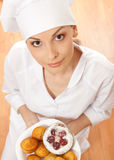 Woman chef holding tray of cookies. Royalty Free Stock Photos