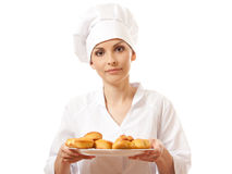 Woman chef holding tray of cookies. Royalty Free Stock Photo
