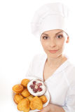 Woman chef holding tray of cookies. Royalty Free Stock Image