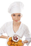 Woman chef holding tray of cookies. Royalty Free Stock Photography