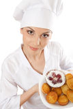 Woman chef holding tray of cookies. Stock Image