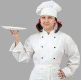 Woman chef holding a  plate Royalty Free Stock Images