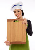 Woman chef holding wooden board Stock Photography