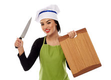 Woman chef holding wooden board and knife Royalty Free Stock Image
