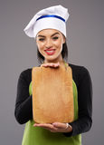 Woman chef holdong wooden board Stock Photos