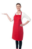Woman chef inviting at restaurant Royalty Free Stock Photos