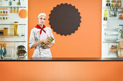 Woman chef in the kitchen interior Stock Images