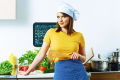 Woman chef in kitchen portrait. Royalty Free Stock Photos