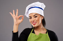 Woman chef making OK sign Royalty Free Stock Photos