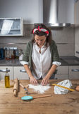 Woman chef making spaghetti Stock Photo
