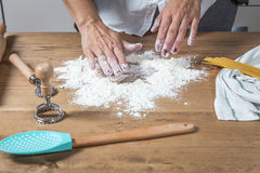 Woman chef making spaghetti Stock Images