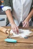 Woman chef making spaghetti Royalty Free Stock Image