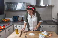 Woman chef making spaghetti Royalty Free Stock Images