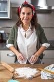Woman chef making spaghetti Royalty Free Stock Photography