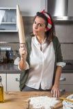 Woman chef making spaghetti Stock Image